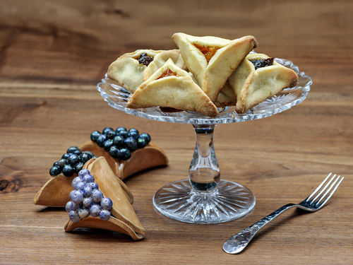 Hamantashen cookies on a cake plate