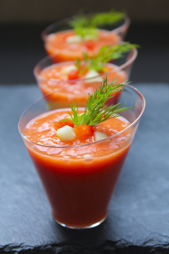 Garnished cocktail glasses of gazpacho