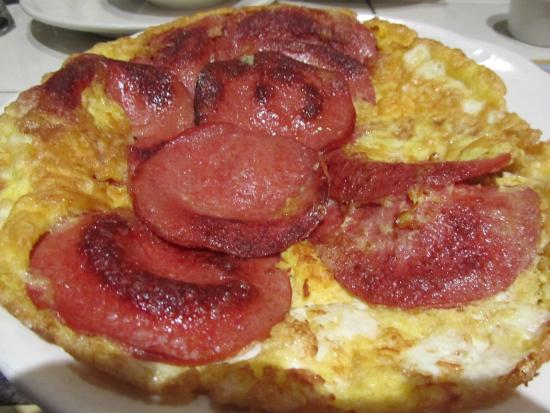 plate of salami and eggs