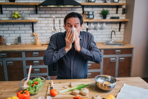 Cook sneezes over food in kitchen